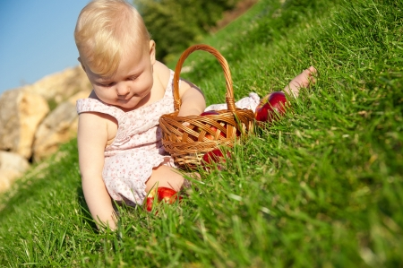 The child, a basket of apples Stock Photo - 16583119
