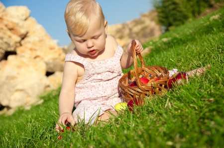 The child, a basket of apples Stock Photo - 16583117