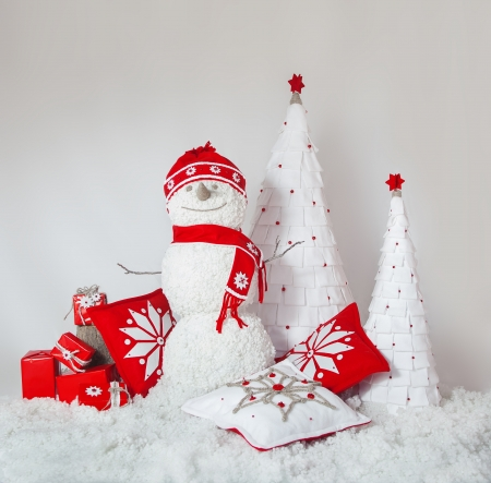 Compositions in studio of Snowman, pillows and gifts, Christmas trees  Bright Christmas decorations on white background  Series  photo