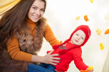 Happy mother and her baby posing sitting in tent outdoor Stock Photo - 16884095