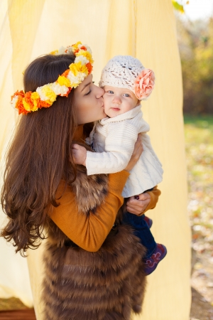 happy mother and her little baby playing outdoor  Series Stock Photo - 16884076