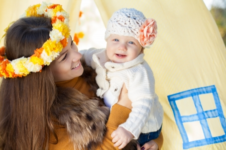 happy mother and her little baby playing outdoor  Series  photo