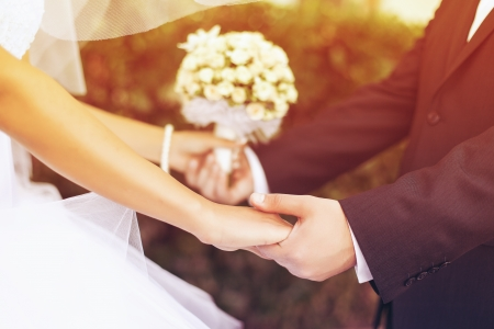 marriage ceremony: Wedding couple holding hands Stock Photo
