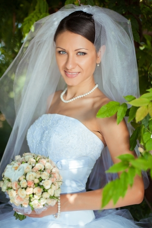 beautiful bride: wedding  young bride posing in her wedding day Stock Photo