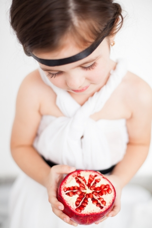 child model view in luxurious white dress with pomegranate Stock Photo - 17041271
