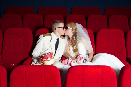 Wedding  kissing bride and groom posing as spectator in the cinema Stock Photo - 17152757
