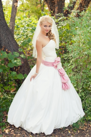 Bride posing standing near tree in forest Stock Photo - 17152722