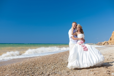 wedding  embracing couple by the sea Stock Photo - 17152771