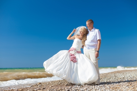 wedding  embracing couple by the sea Stock Photo - 17152802