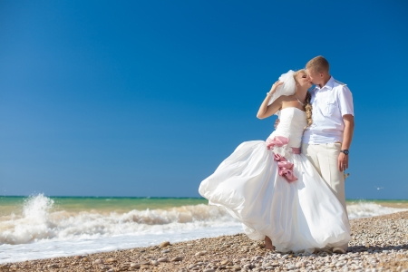 wedding  embracing couple by the sea Stock Photo - 17152801