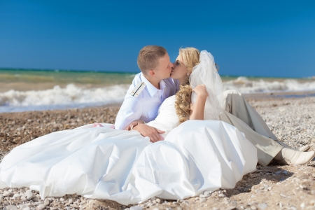 wedding  embracing couple by the sea photo