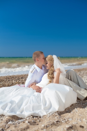 wedding  embracing couple by the sea Stock Photo - 17152792
