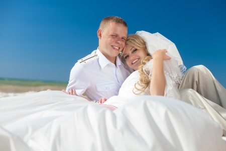 wedding  embracing couple by the sea Stock Photo - 17152807