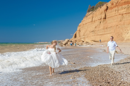 Wedding  beautiful couple run on the beach Stock Photo - 17152781