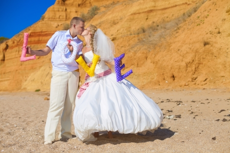 wedding  couple posing on the shore and holding the letters with the word  LOVE Stock Photo - 17152721