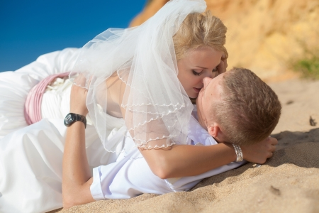 wedding  embracing couple by the sea Stock Photo - 17152775