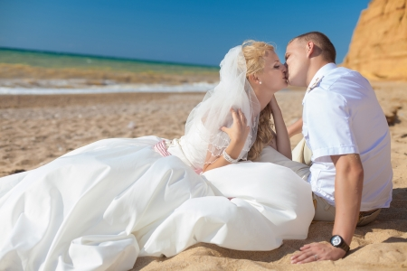 wedding  embracing couple by the sea Stock Photo - 17152788