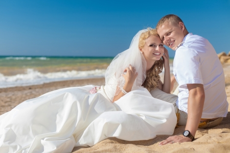 wedding  embracing couple by the sea Stock Photo - 17152793