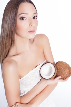 beautiful woman with perfect skin holding coconut over white background Stock Photo - 17229229