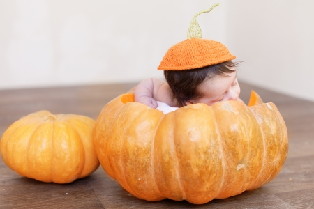 Portrait of newborn in pumpkin photo