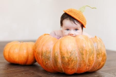 Portrait of newborn in pumpkin