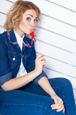 Young woman in blue denim holding heart Stock Photo - 17229255