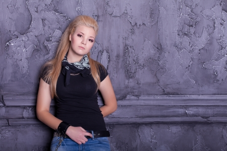 teen punk girl against wall background Stock Photo - 17229247