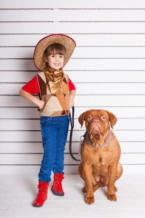 Kid with dog. Portrait in the studio Stock Photo - 17194249