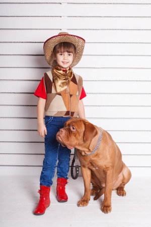 Kid with dog. Portrait in the studio Stock Photo - 17194238