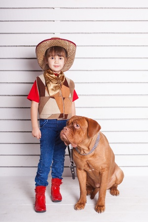 Kid with dog. Portrait in the studio Stock Photo - 17194240