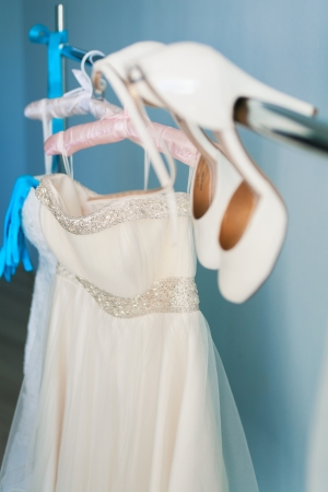wedding dress and accessories on hanger photo