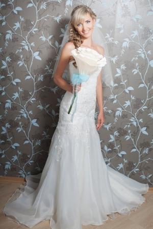 Beautiful blond bride portrait in white dress Stock Photo - 17416219