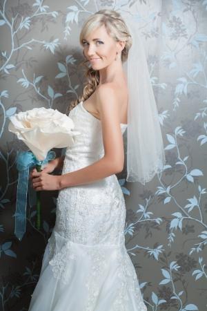 Beautiful blond bride portrait in white dress Stock Photo - 17416222