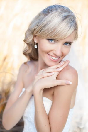 Portrait of beautiful blond bride. Wedding dress. Stock Photo - 17416213