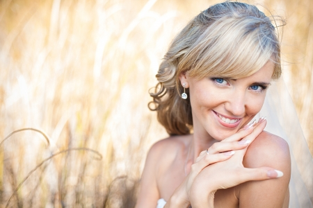 Portrait of beautiful blond bride. Wedding dress. Stock Photo - 17416204