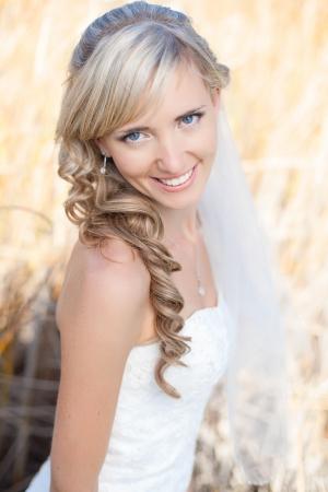 Portrait of beautiful blond bride. Wedding dress.