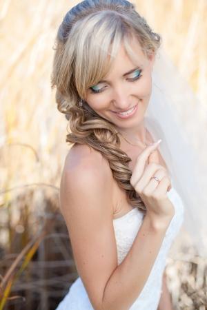 Portrait of beautiful blond bride. Wedding dress. Stock Photo - 17416206
