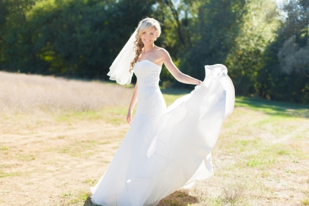 Portrait of beautiful blond bride in action  Wedding dress  Stock Photo - 17416229
