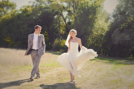 Beautiful bride and groom in action in their wedding day  Park  Stock Photo - 17416215