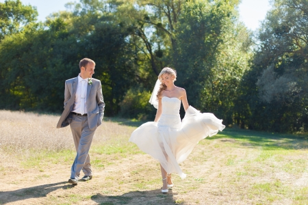Beautiful bride and groom in action in their wedding day  Park  Stock Photo - 17416189