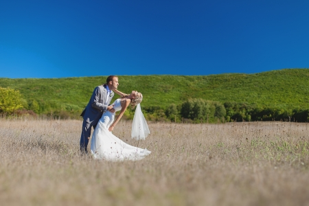 Beautiful bride and groom in action in their wedding day  Park  Stock Photo - 17460880