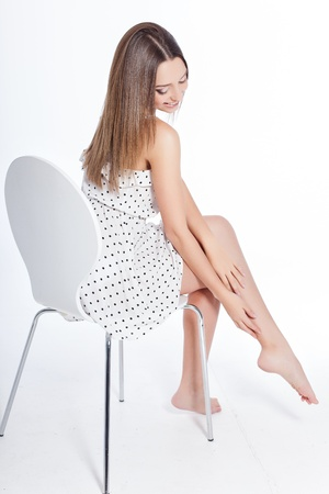 healthy woman with attractive perfect legs over white background photo