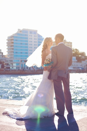 wedding  couple in love bride and groom posing on waterfront in the urban landscape Stock Photo - 17480219