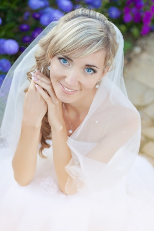 Wedding  close up portrait of beautiful blond bride photo