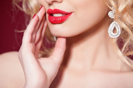 horizontal: Close-up portrait of young blonde woman with beautiful lips. Red color