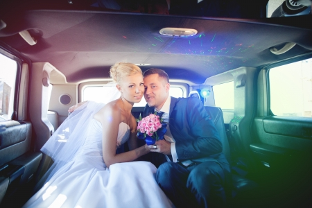 wedding couple in limousine