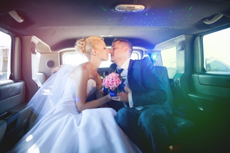 wedding couple in limousine photo