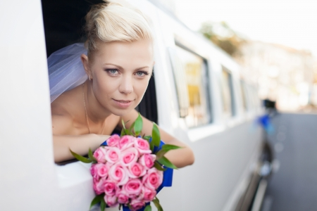 wedding portrait of bride in car window photo