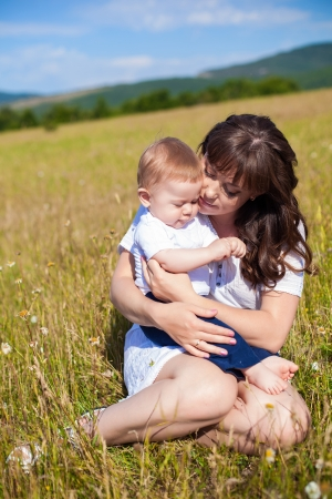 motherly: Family - happy mom and her son smiling at nature