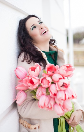 Beautiful young brunette woman with pink tulips Stock Photo - 18061353